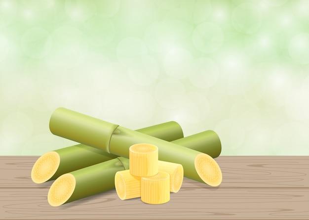 Ilustración de la caña de azúcar, la caña en la mesa de madera y el fondo verde suave de la naturaleza de bokeh