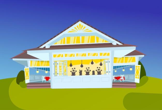 Ilustración de una casa moderna iluminada