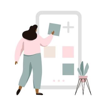 Ilustración del concepto de constructor de aplicaciones móviles. mujer usando la pantalla grande con herramientas de construcción del sitio.