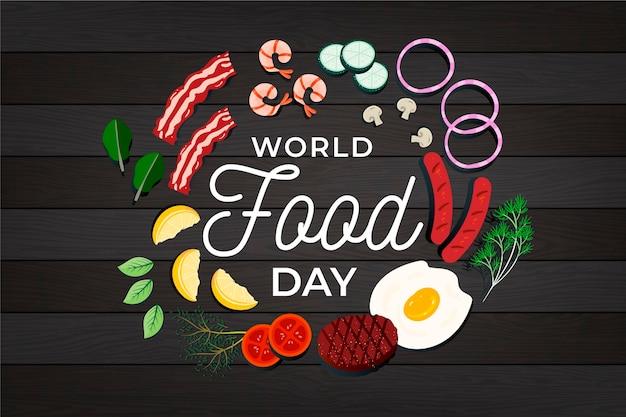 Ilustración del día mundial de la comida de diseño plano sobre fondo de madera