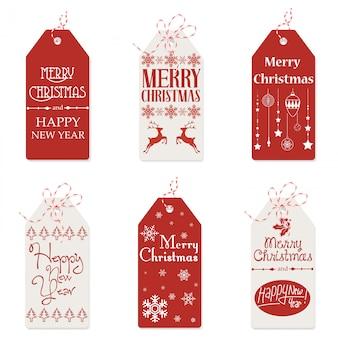 Ilustración de etiquetas rojas y blancas con pequeños dibujos y palabras de feliz navidad.