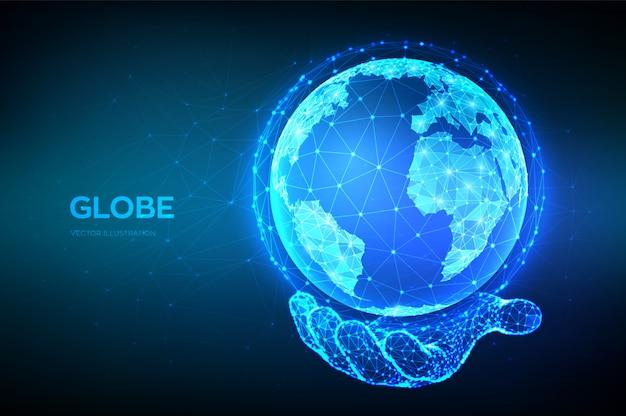 Ilustración del globo terráqueo. resumen bajo planeta poligonal en mano. conexión de red global.