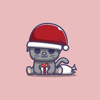 Ilustración de un lindo gato con un gorro de papá noel y un regalo de navidad