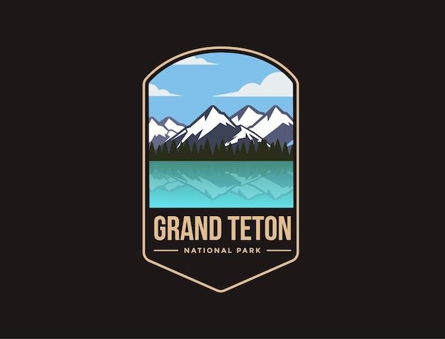 Ilustración del logotipo del parche del emblema del parque nacional grand teton sobre fondo oscuro