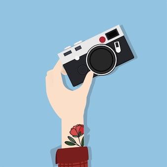 Ilustración de la mano que sostiene la cámara