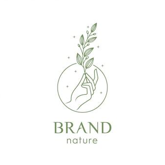 Ilustración de una mano sosteniendo una hoja para logo