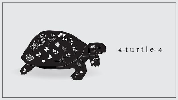Ilustración de una tortuga negra con flores y plantas blancas.