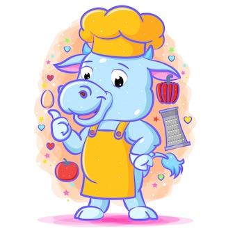 La ilustración de la vaca azul con el sombrero amarillo de pie alrededor de las verduras.