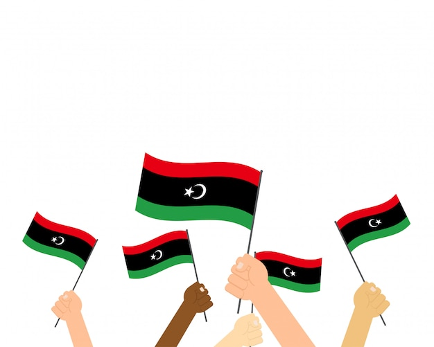 Ilustración de vector de manos sosteniendo banderas de libia