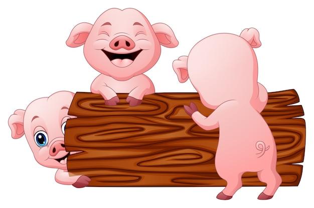 Ilustración vectorial de tres pequeños dibujos animados de cerdo en el registro
