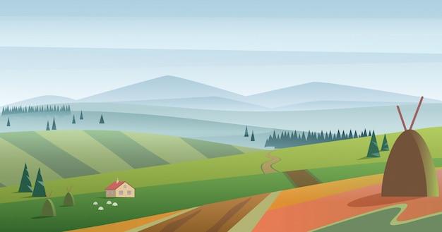 Imagen de colinas verdes y pradera con casa de campo contra montañas azules en neblina. paisaje de campo de niebla de la mañana.
