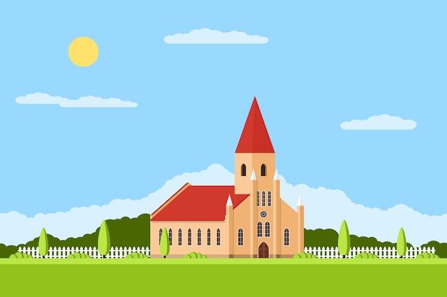 Imagen de una iglesia católica romana con valla y árboles, paisaje de verano,