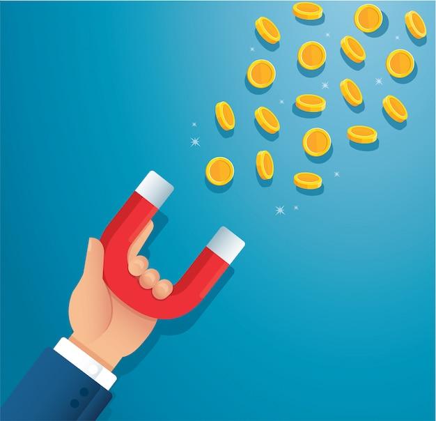 Imán de explotación de mano. atrayendo el concepto de dinero