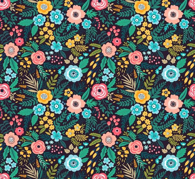 Increíble patrón floral con flores de colores brillantes, plantas, ramas y bayas sobre un fondo negro.
