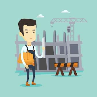 Ingeniero con casco y plano.
