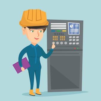Ingeniero industrial trabajando en panel de control.