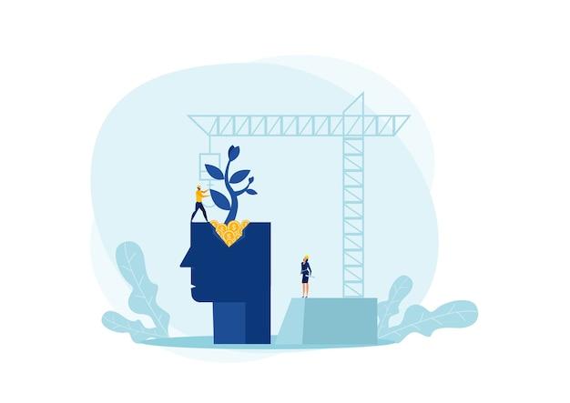 Ingeniero planta árbol en la cabeza humana con concepto de mentalidad de crecimiento de construcción de grúas