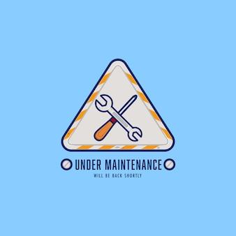 Ingeniero reparador bajo signo de logotipo de insignia de mantenimiento con destornillador y llave para mantenimiento o construcción de sitios web