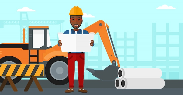 Ingeniero sosteniendo un plano.