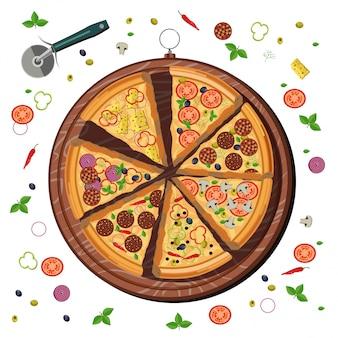 Ingredientes de la pizza en la tabla de cortar de madera
