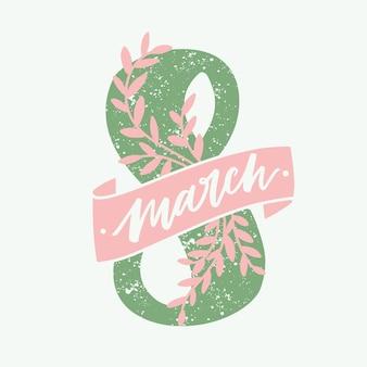Inscripción del 8 de marzo escrita a mano con fuente caligráfica y decorada con elegante cinta rosa y ramas con hojas sobre fondo claro