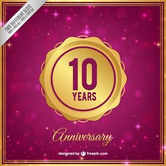 Insignia dorada de aniversario de diez años
