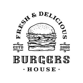 Insignia del logotipo de hamburguesa en diseño vintage