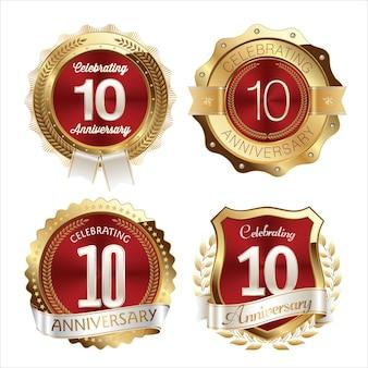 Insignias de aniversario de oro y rojo celebración de años