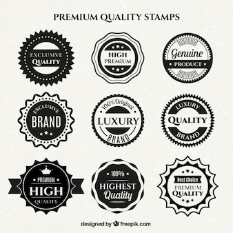 Insignias de calidad alta negras y blancas en diseño plano