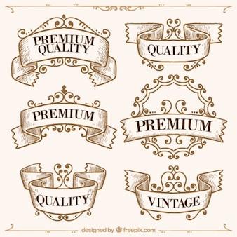 Insignias de calidad suprema dibujadas a mano