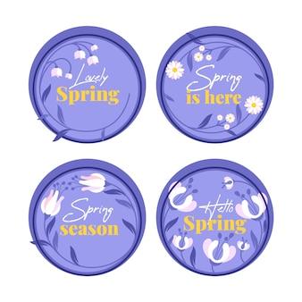 Insignias circulares azules con flores de primavera