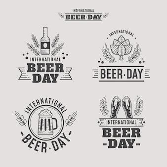 Insignias del día internacional de la cerveza de diseño plano