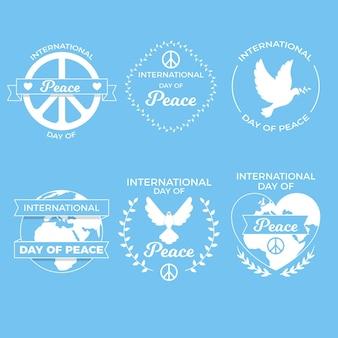 Insignias del día internacional de la paz de diseño plano