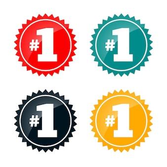 Insignias de etiqueta número uno en cuatro colores.