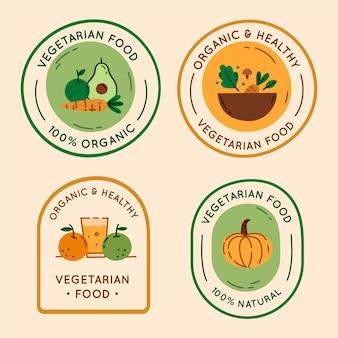Insignias vegetarianas de diseño plano dibujadas a mano