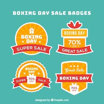 Insignias de ventas del boxing day sobre un fondo turquesa