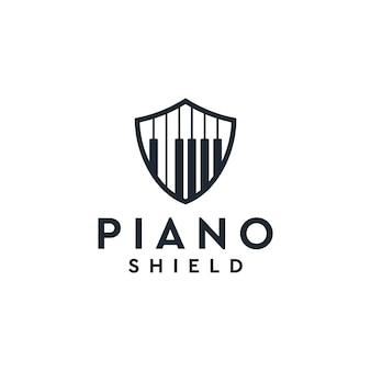 Inspiración del logo del escudo de piano Vector Premium