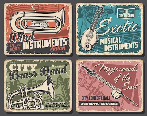 Instrumentos musicales y carteles retro de conciertos acústicos en vivo.
