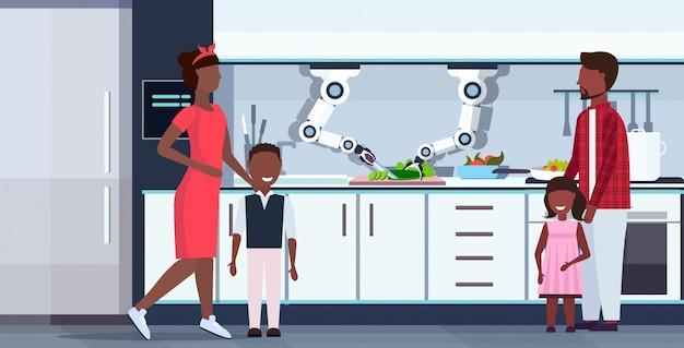 Inteligente práctico chef robot cortar pepino a bordo robot asistente innovación tecnología artificial inteligencia concepto feliz familia de pie juntos moderno cocina interior horizontal