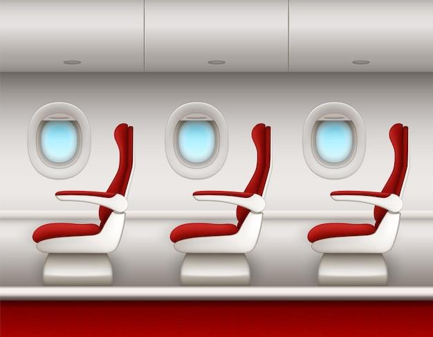 Interior del avión con fila de asientos para pasajeros, ventanillas de ojo de buey abiertas y compartimentos para equipaje. vista lateral de la cabina del avión con asientos rojos de clase económica o premium, salón de avión