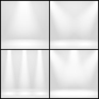 Interior blanco vacío, sala de estudio fotográfico con fondos de lámparas fijados.
