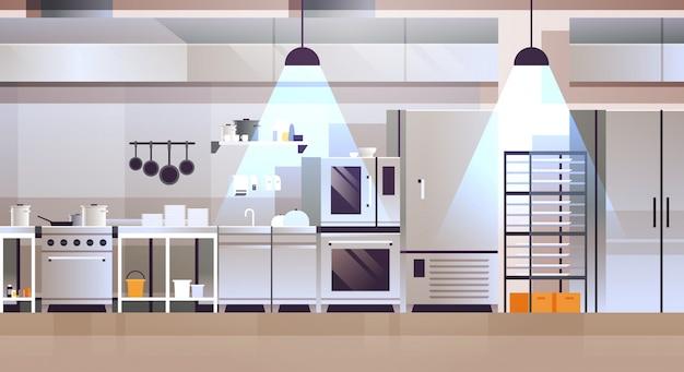 Interior moderno de cocina profesional de cafetería o restaurante con utensilios de cocina y equipo de cocina.