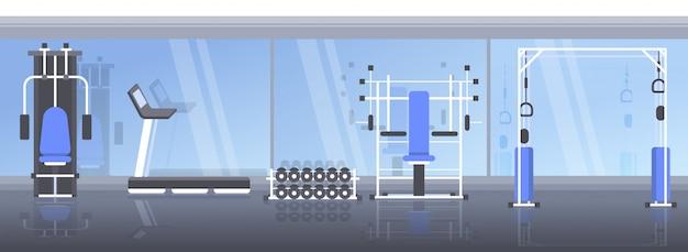 Interior moderno gimnasio deportivo vacío ningún club de salud con equipo de entrenamiento aparato de entrenamiento estilo de vida saludable concepto horizontal
