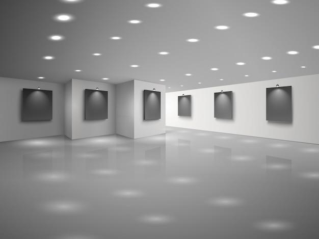 Interior de la sala blanca vacía con lienzos negros en blanco