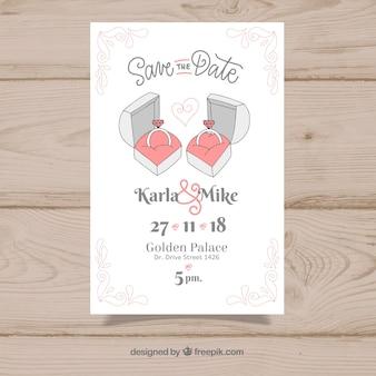 Invitación de boda con anillos dibujados a mano