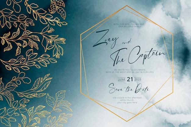 Invitación de boda azul marino con marco dorado y hojas