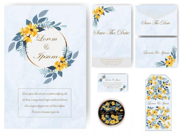 Invitación de boda y etiqueta sobre fondo de mármol azul