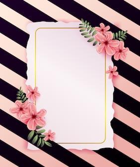 Invitación de boda con flores de primavera sobre fondo rosa.
