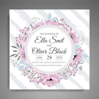 Invitación de boda con marco de flores de color rosa y azul claro