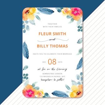 Invitación de boda con pluma y marco floral de acuarela